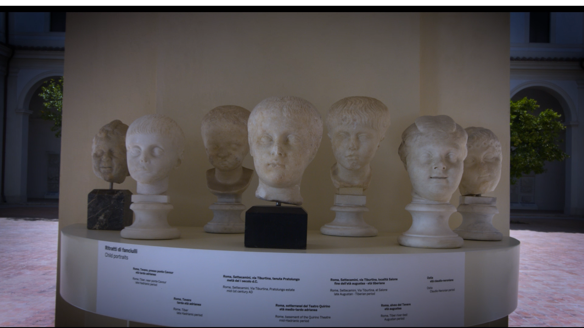 Seven marble busts of children's heads