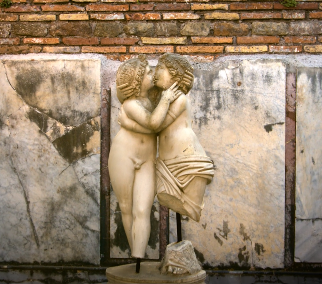 Statue of two figures, nude and semi-nude, embracing