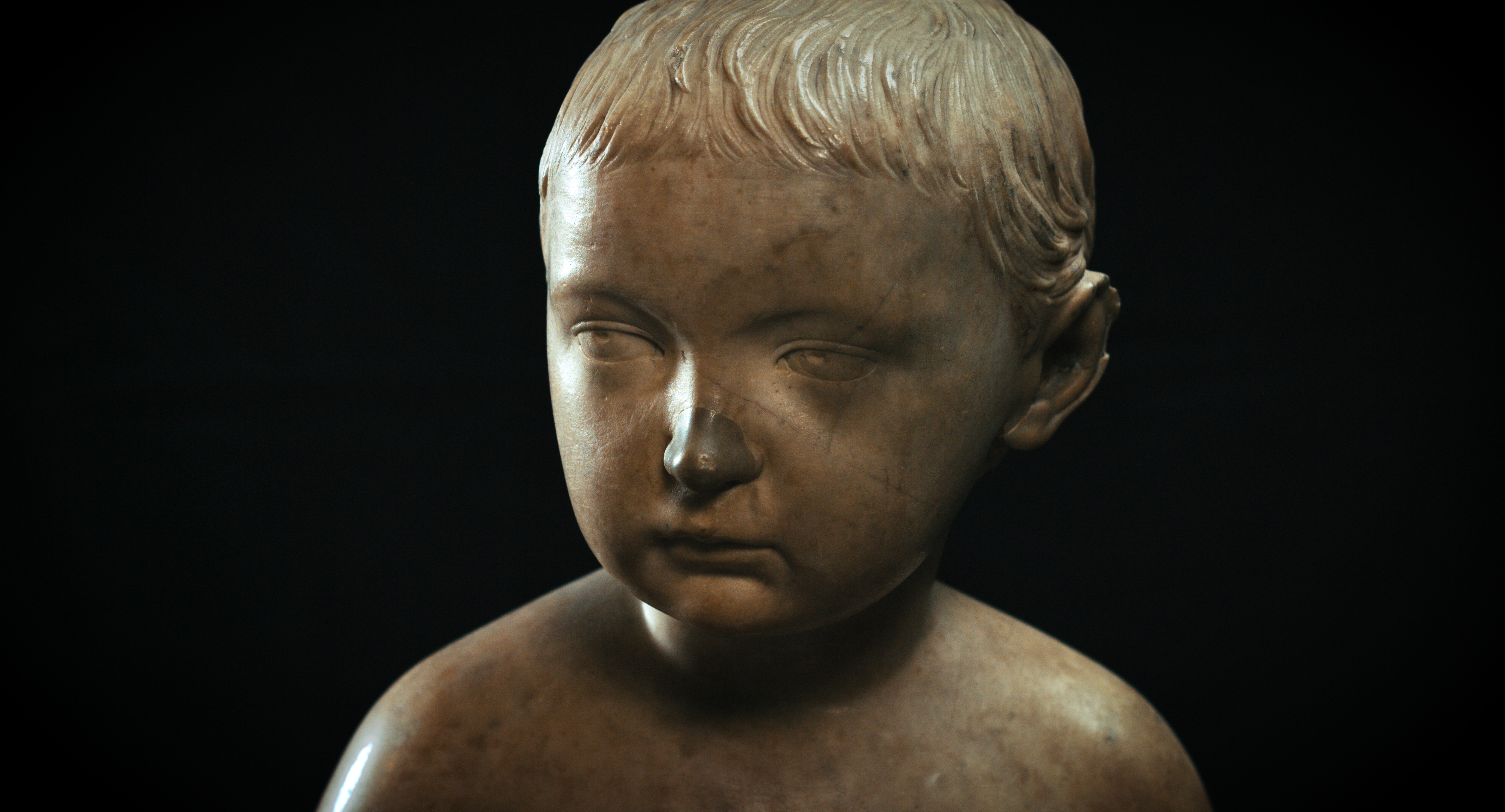 Marble bust of a boy's head and shoulders