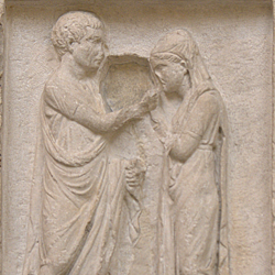 Funerary inscription and carving of a freedman and his wife