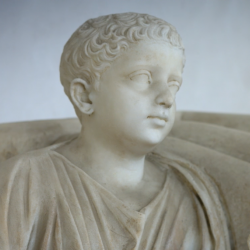 statue of a boy with a fig