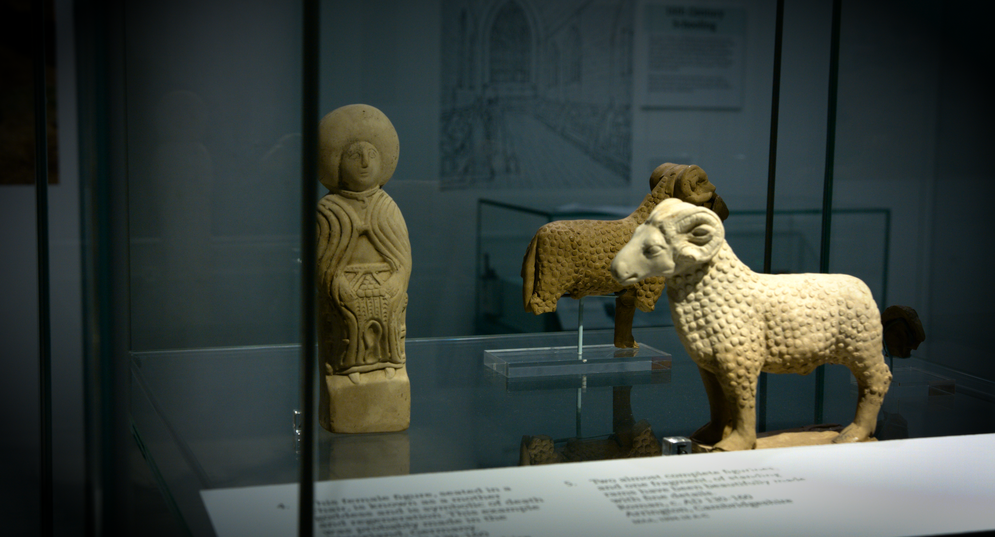 Figurines of a seated woman and of rams